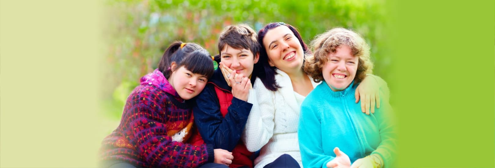 Portrait of happy women with disability having fun in spring park